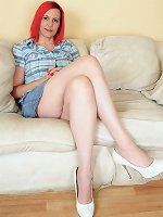 Redhead milf Penelope shows us stretched hairy upskirt